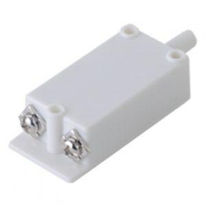 Accesorio tamper switch en color blanco.